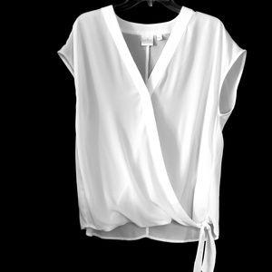 White sleeveless wrap style shirt size L